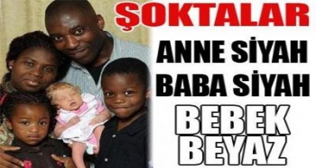 Anne siyah baba siyah bebek  beyaz