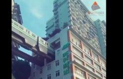 Çin de apartmanların içinden geçen metro...